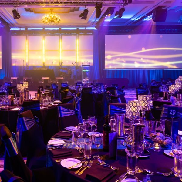 themed gala dinner with purple lighting and crystal lamps on table