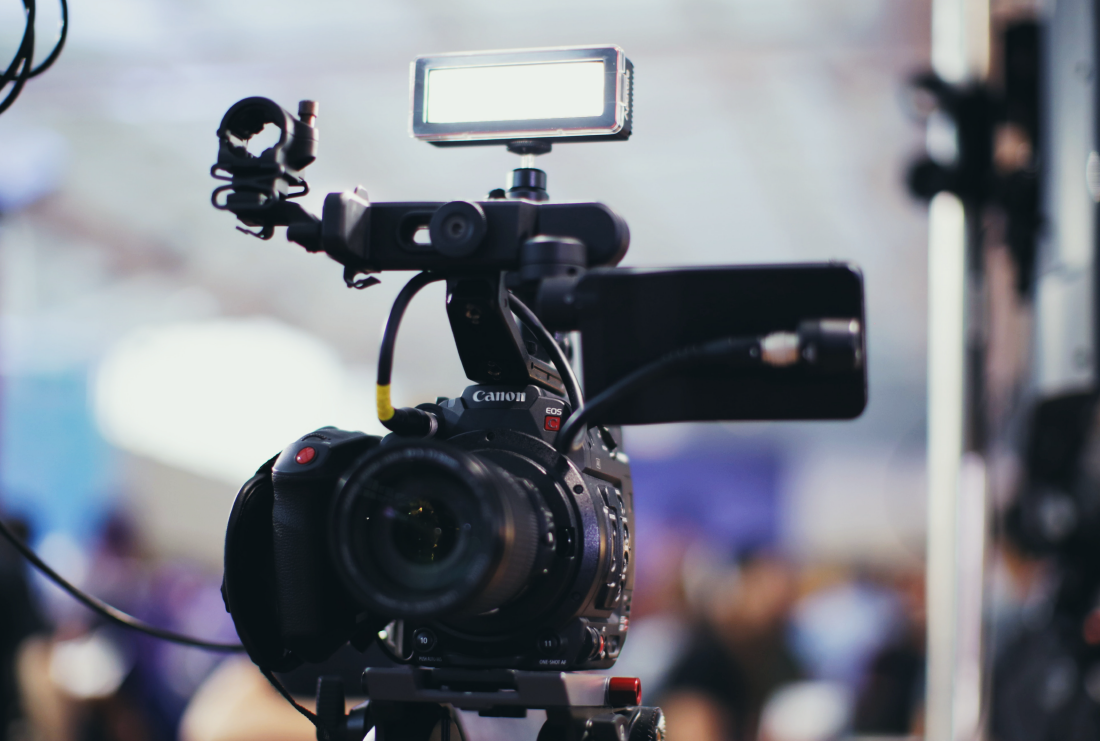 Camera recording a live stream of a corporate event